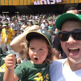 Brett Rounsaville and his young daughter at an A's game