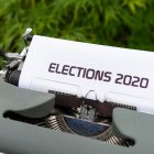 Old typewriter with piece of paper that says ELECTIONS 2020